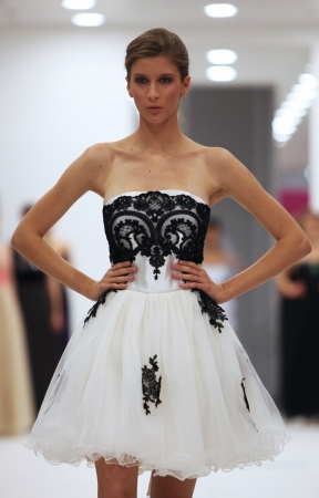Fashion model in cocktail dress made by Ana Milani on  Wedding Expo  show in the Westgate Shopping City in Zagreb, Croatia on October 12, 2013