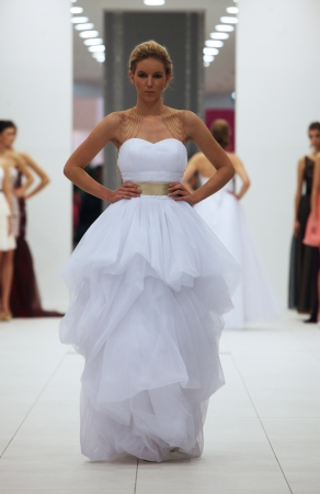 Fashion model in wedding dress made by Ana Milani on  Wedding Expo  show in the Westgate Shopping City in Zagreb, Croatia on October 12, 2013