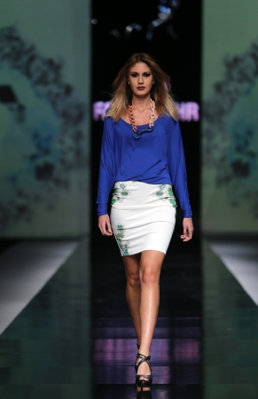 Fashion model wearing clothes designed by Petra Vuletic and Sasa Hortig on the  Fashion hr  show on October 17, 2013 in Zagreb, Croatia