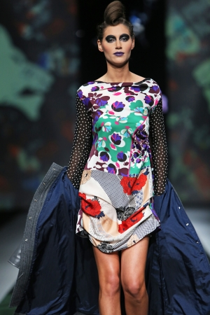Fashion model wearing clothes designed by Zoran Aragovic on the  Fashion hr  show on October 17, 2013 in Zagreb, Croatia  Editorial