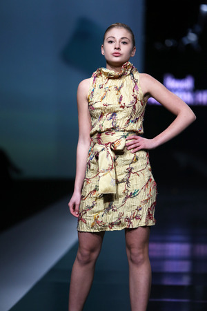 ZAGREB, CROATIA - OCTOBER 17: Fashion model wearing clothes designed by Ivana Popovic on the Fashion.hr show on October 17, 2013 in Zagreb, Croatia.
