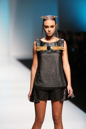 Fashion model wearing clothes designed by Marina Design on the  Fashion hr  show on October 17, 2013 in Zagreb, Croatia