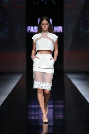 Fashion model wearing clothes designed by Aleksandar Zarevac on the  Fashion hr  show on October 18, 2013 in Zagreb, Croatia