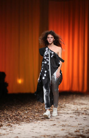 demode: ZAGREB, CROATIA - OCTOBER 25: Fashion model wearing clothes designed by Madame Demode on the Cro a Porter show on October 25, 2013 in Zagreb, Croatia.