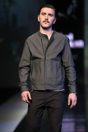 frock coat: Fashion model wearing clothes designed by Boris Banovic on the  Fashion hr  show on October 18, 2013 in Zagreb, Croatia