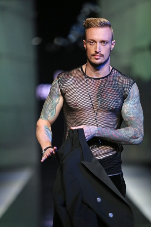 Fashion model wearing clothes designed by Boris Banovic on the  Fashion hr  show on October 18, 2013 in Zagreb, Croatia