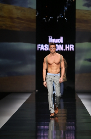 frock coat: Fashion model wearing clothes designed by Ivica Klaric on the  Fashion hr  show on October 19, 2013 in Zagreb, Croatia