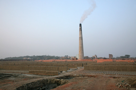 third world economy: Brickfield is a large landed area, used for manufacturing bricks from mud, soil, clay and sand  Tools and machines for making bricks are very rudimentary, January 14, 2009 in Sarberia, West Bengal, India  Editorial