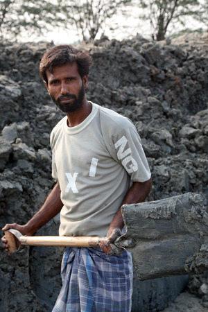 third world economy: Brick field  Laborers are carrying deposited soil for making raw brick  on January 16, 2009 in Sarberia, West Bengal, India  Editorial
