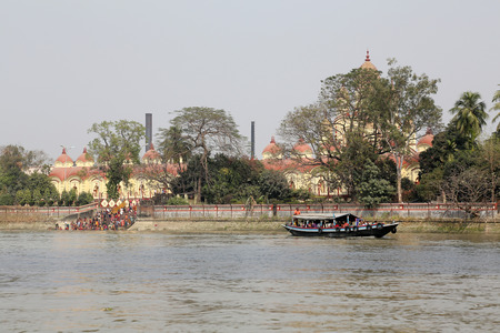 dome of hindu temple: Hindu people bathing in the ghat near the Dakshineswar Kali Temple in Kolkata on February 14, 2014 Editorial