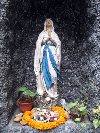 of our lady: Statue of Our Lady of Lourdes at Mother House, where Mother Teresa used to live on Jan 27, 2009 in Kolkata, West Bengal, India