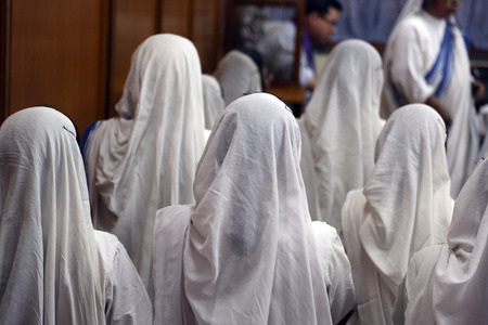 house of prayer: Sisters of Mother Teresa s Missionaries of Charity in prayer in the chapel of the Mother House, Kolkata, India at February 08, 2014
