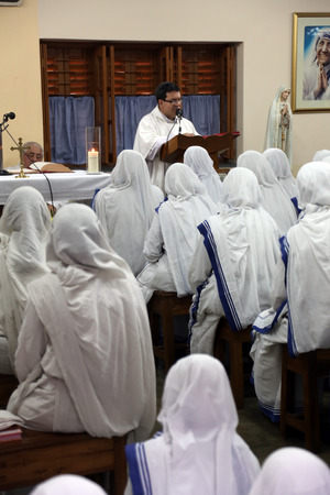 Sisters of The Missionaries of Charity of Mother Teresa at Mass in the chapel of the Mother House, Kolkata, India at February 07, 2014