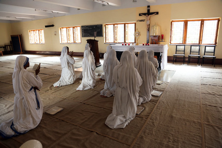 Sisters of Mother Teresa s Missionaries of Charity in prayer in the chapel of the Mother House, Kolkata, India at February 08, 2014