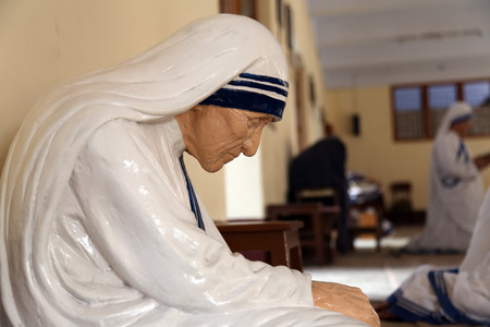 Statue of Mother Teresa in the chapel of the Mother House, Kolkata, India at 8 February 2014  The statue was made in the pose in which the Mother prayed
