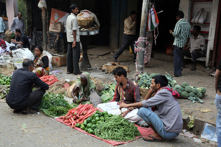 Street trader sell vegetables outdoor on February 11, 2014 in Kolkata India  Only 0 81  of the Kolkata s workforce employed in the primary sector  agriculture