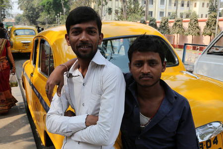Indian taxi driver posing in front of his cab in Kolkata on February 14, 2014  The car is Hindustan Ambassador, manufactured since 1958
