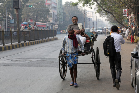 Rickshaw driver working on February 15, 2014 in Kolkata, India  Rickshaws have been around for more than a century, but they could soon be a thing of the past