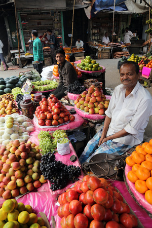 kolkata: Street trader sell fruits outdoor on February 11, 2014 in Kolkata India  Only 0 81  of the Kolkata s workforce employed in the primary sector  agriculture
