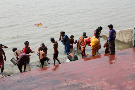 god walking: Hindu people bathing in the ghat near the Dakshineswar Kali Temple on February 14, 2014  At present time this river is being polluted tremendously