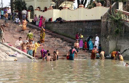 dome of hindu temple: Hindu people bathing in the ghat near the Dakshineswar Kali Temple on February 14, 2014  At present time this river is being polluted tremendously