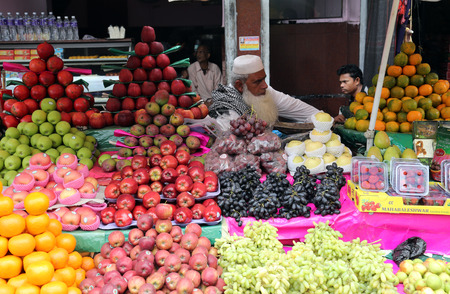 Street trader sell fruits outdoor on February 15, 2014 in Kolkata India  Only 0 81  of the Kolkata s workforce employed in the primary sector  agriculture