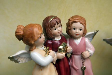 shopwindow: Three porcelain angels in a shop-window