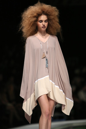 Fashion model wearing clothes designed