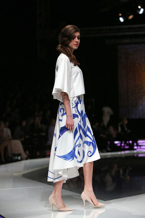 Fashion model wearing clothes designed by Krie Design on the CRO A PORTER  show on April 12, 2014 in Zagreb, Croatia