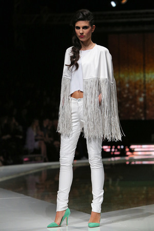 Fashion model wearing clothes designed by Krie Design on the Fashion.hr show on March 27, 2014 in Zagreb, Croatia.