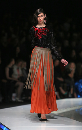 sever: Fashion model wearing clothes designed by Robert Sever on the
