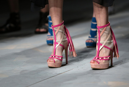 Fashion model wears shoes made by Ivan Ledenko on CRO A PORTER show on April 11, 2014 in Zagreb, Croatia.