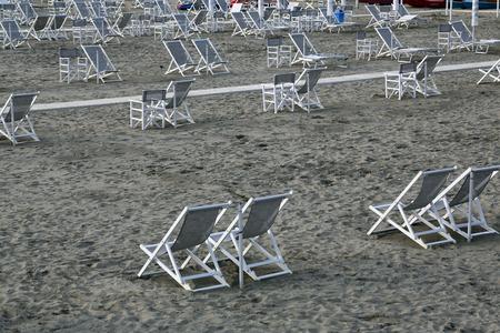 viareggio: Typical Italian beach chairs in Viareggio, one of the most well known summer italian vacation spots Stock Photo