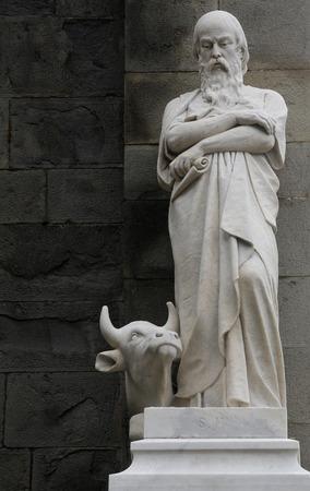 Saint Luke the Evangelist statue on the portal of the Saint John the Baptist church in Riomaggiore, Liguria, Italy