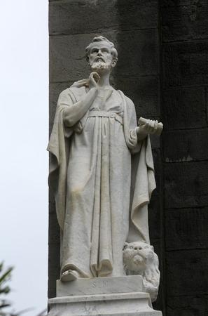 Saint Mark the Evangelist statue on the portal of the Saint John the Baptist church in Riomaggiore, Liguria, Italy