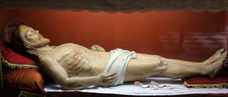 easter triduum: Statue of Jesus Christ in the tomb in the Church of the Holy Sacrament in Portoferraio, Elba, Italy