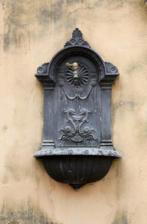 Old Drinking Fountain in Italian City photo