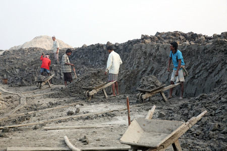 third world economy: Brick field  Laborers are carrying deposited soil for making raw brick  on January 14, 2009 in Sarberia, West Bengal, India  Editorial