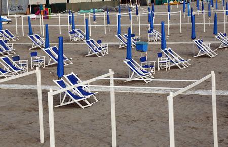 viareggio: Typical Italian beach umbrellas and chairs in Viareggio, one of the most well known summer Italian vacation spots Stock Photo