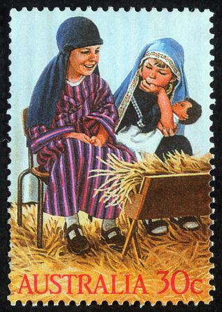 Christmas stamp printed in Australia shows children play to the Holy Family, circa 2004