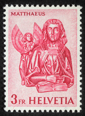 memling: Stamp printed in Switzerland showing Saint Mattheus the Evangelist, circa 1982 Editorial
