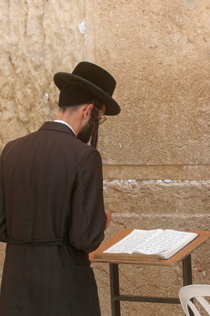 hasidim: Orthodox man prayers at Western wall of Jerusalem