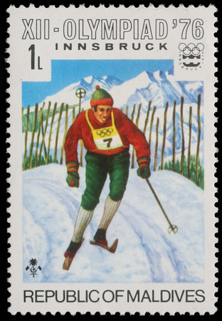 A stamp printed by Maldives, shows Alpine skiing at the Winter Olympics in Innsbruck, circa 1976