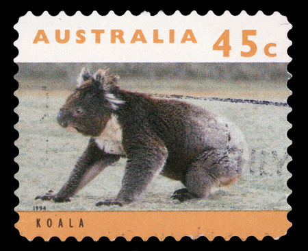 walk of fame: Stamp printed in Australia shows a koala bear sitting on grassy ground, circa 1994  Stock Photo