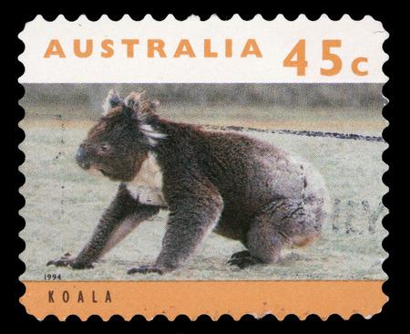 walk of fame: Stamp printed in Australia shows a koala bear sitting on grassy ground, circa 1994  Stock Photo
