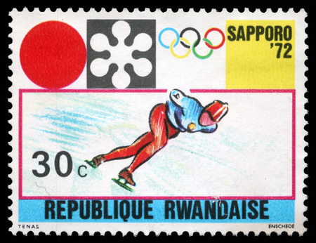 Stamp printed in Rwanda shows Sapporo Olympic Emblem and Speed Skating, circa 1972