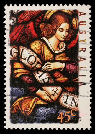gloria: Stamp printed in Australia shows Angel with Gloria in excelsis Deo Banner, circa 1995