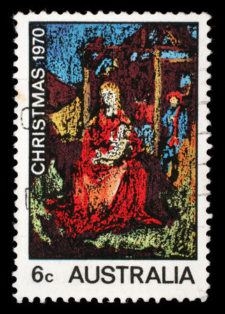 Stamp printed in the Australia shows MadoNna and Child, Painting by William Beasley, Christmas, circa 1970