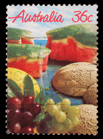 collectible: Stamp printed in Australia shows image of a spread of mouth watering fruit, circa 1987