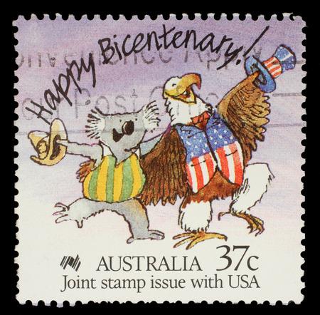 Stamp printed in Australia shows Happy Bicentenary  Caricature of Australian Koala and American Bald Eagle, circa 1988 photo